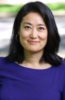 Headshot of Amy Hsin with black hair and blue blouse.