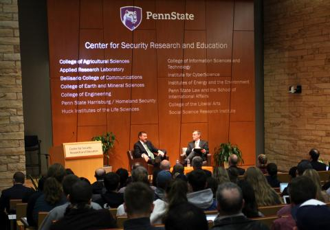 Photo of two men giving a presentation for the Center for Security Research and Education.