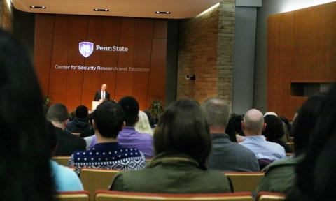 Photo of a presentation by the Center for Security Research and Education at Penn State.