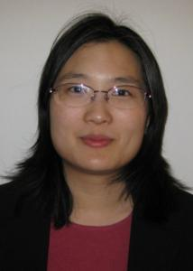 Headshot of Charleen Hsuan with long, dark hair wearing glasses, a pink shirt and black suit jacket.
