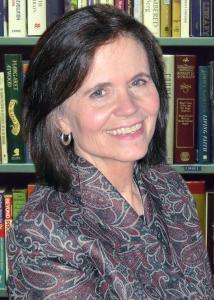 Headshot of Diane Felmlee in a library with mid-length, brown hair wearing a patterned jacket.
