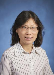 Headshot of Pui-Wa Lei with mid-length, dark hair and glasses wearing striped dress shirt.