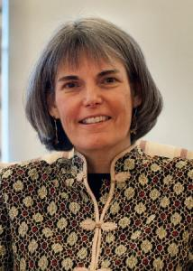 Headshot of Susan McHale with mid-length, grey hair wearing patterned top.