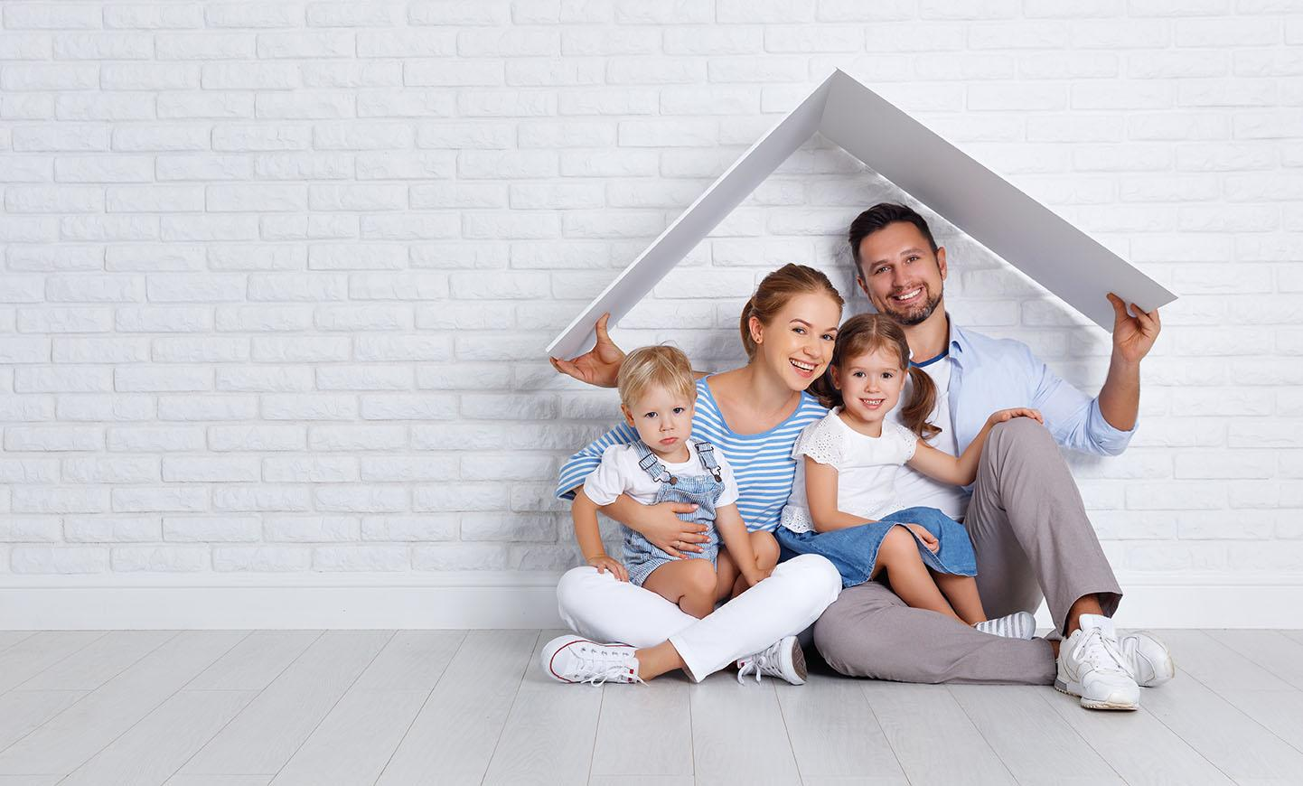 Concept housing a family: mother, father and children in a new home.